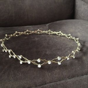 Gold plated tiara with faux diamond studs.